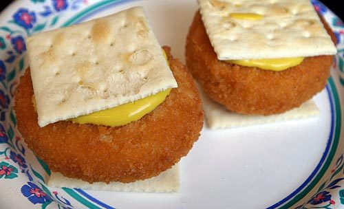 50 things Baltimore foodies must try [Pictures] - Coddies on a cracker from a rowhouse bar.