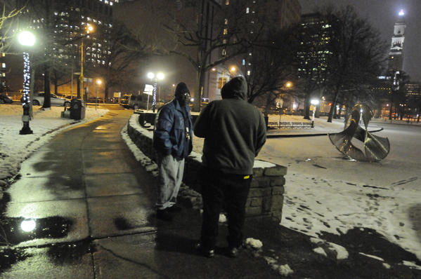 Tony Mack, outreach coordinator, Immaculate Conception Shelter & Housing Corporation, approaches a man in Bushnell Park as he was looking for homeless people on the streets.