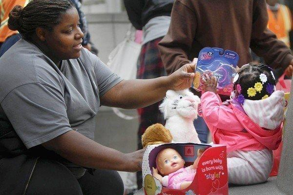 Latoya Williams brought daughter Madison to the Midnight Mission for her first Christmas.