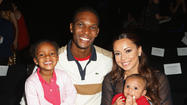 VIDEO - Miami Heat hoopster Chris Bosh puts family in ad