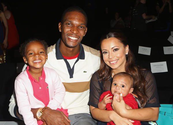 NBA Player Chris Bosh, Adrienne Williams Bosh, and children attend the Lacoste Spring 2013 fashion show during Mercedes-Benz Fashion Week at The Theatre, Lincoln Center on September 8, 2012 in New York City.