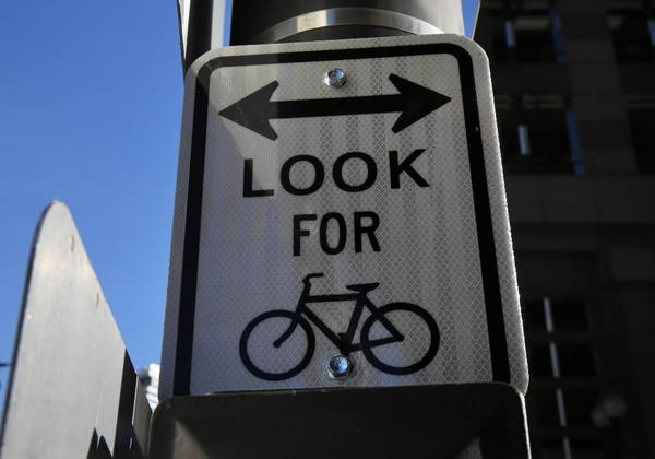 Look for bicycle signage along Dearborn Street near Lake Street in Chicago.