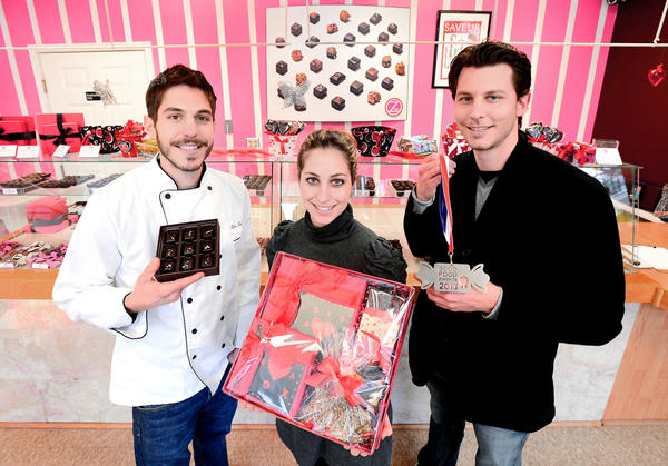On Thursday, Feb. 7, Gifts Inn Boonsboro hosts a Valentine¿s jewelry exhibit and champagne chocolate reception featuring Zoe¿s Chocolates. The chocolate shop in Waynesboro, Pa., is run by siblings, from left, Petros Tsoukatos, Zoe Tsoukatos and Pantelis Tsoukatos.