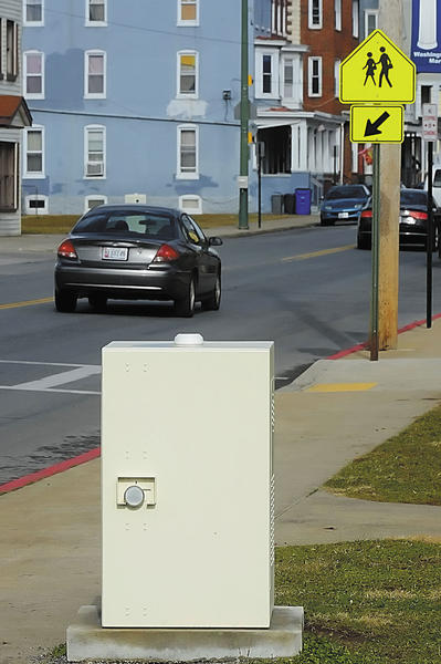 A speed camera set up in front of Bester Elementary School on S. Potomac Street.