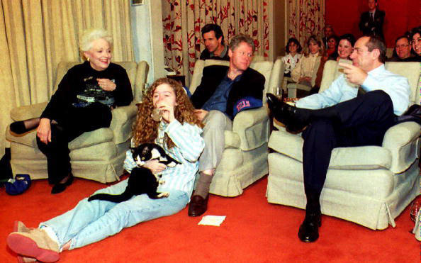 President Bill Clinton, New York Governor Mario Cuomo, Texas Governor Ann Richards, Clinton's daughter, Chelsea, and the family cat, Socks, watch Superbowl XXVII.
