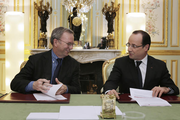 French President Francois Hollande, right, meets with Google Executive Chairman Eric Schmidt at the Elysee Palace in Paris.