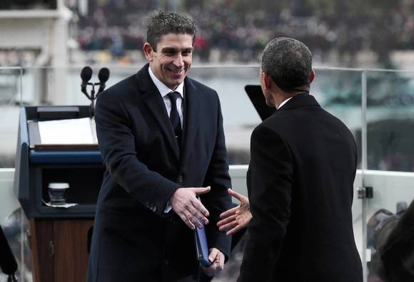 President Barack Obama greets poet Richard Blanco during the presidential inauguration in Washington
