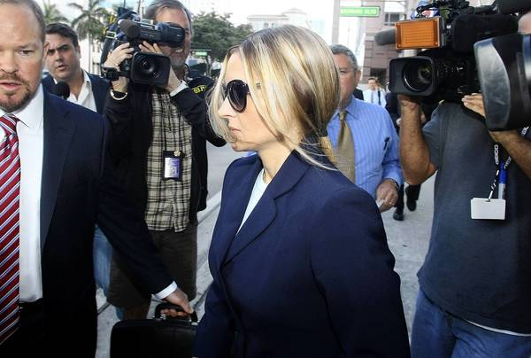 Kim Rothstein, Scott Rothstein's wife, leaves the federal courthouse after she plead guilty to a plot to hide more than $1 million in jewels from the feds.