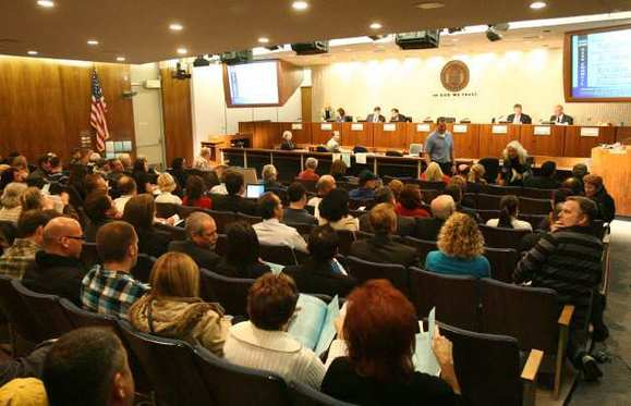Costa Mesa City Council Chambers are filled to capacity as city officials prepare to vote on outsourcing city services in March 2011.