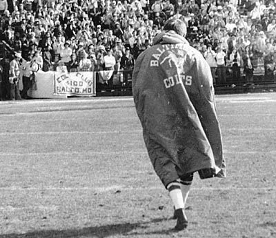 Sun archives: Baltimore Colts photos - John Unitas walks off the field at Memorial Stadium
