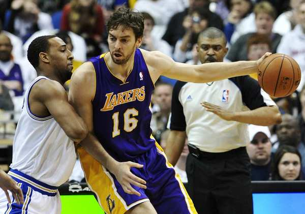 Lakers power forward Pau Gasol works in the post against Timberwolves power forward Derrick Williams. This season will start off with a challenge for the Lakers.