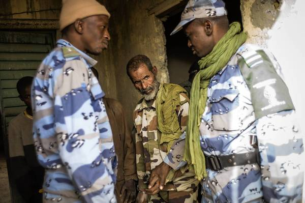 Malian forces stand watch at a military camp in Timbuktu, where French-led troops drove out Islamic militants this week.