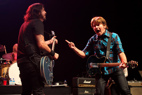 Dave Grohl, left, goes face to face with John Fogerty at the Sound City concert.