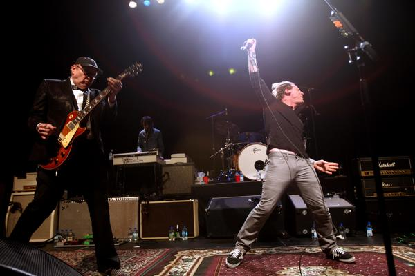 Rick Nielsen, left, of Cheap Trick and Corey Taylor of Slipknot let fly at the Sound City concert.