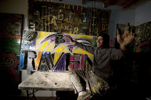 Cornish talks about one of his new Ravens-themed works in his Fells Point studio.