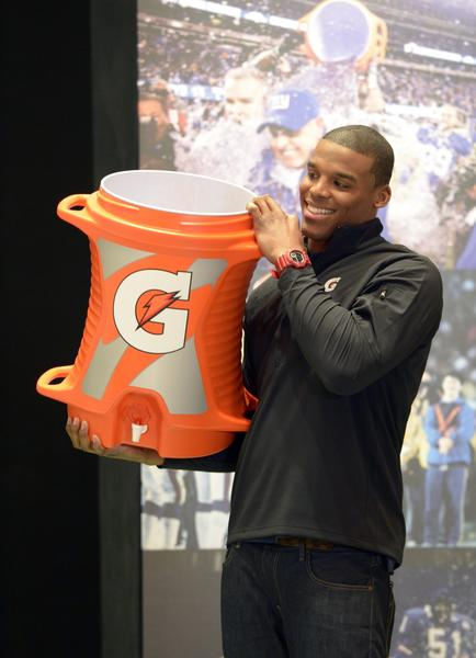 Carolina Panthers quarterback Cam Newton holds a bucket of Gatorade on radio row at the New Orleans Convention Center in preparation for Super Bowl XLVII.