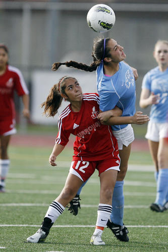Burroughs' Brianna Castillo, left, and CV's Katie Callister fight for the ball during a game at John Burroughs High School in Burbank on Friday, February 1, 2013.