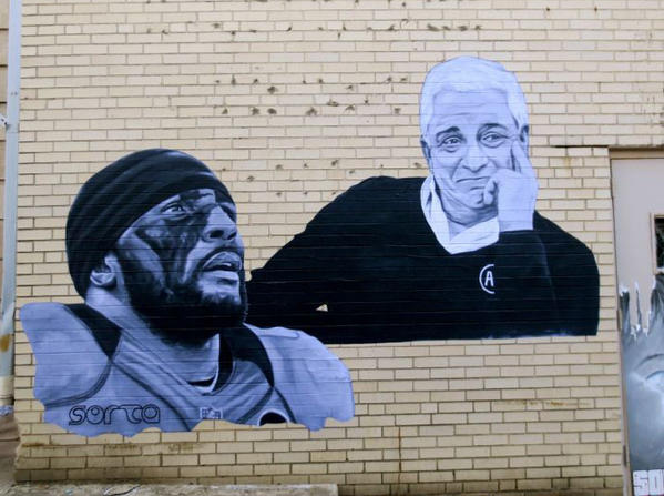 Street artist Sorta has pasted these images of Ray Lewis and Art Modell around town.