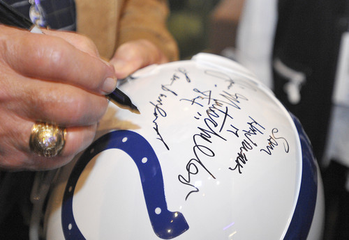 Sun archives: Baltimore Colts photos - Leo Sanford signs a helmet