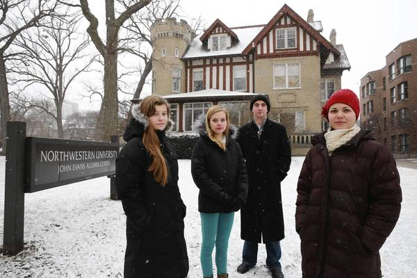 Native American and Indigenous Student Alliance members Heather Menefee, 19, from left, Aileen McGraw, 20, Adam Mendel, 22, and Bethany Hughes, 31, stand outside the John Evans Alumni Center at Northwestern University in Evanston. The student group petitioned the university to look into Evans' connections to the Sand Creek Massacre when he was Colorado's territorial governor in 1864.