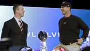 NEW ORLEANS — John Harbaugh, coach of the Baltimore Ravens, stepped onto the convention center stage wearing a suit, a tie and a smile.
