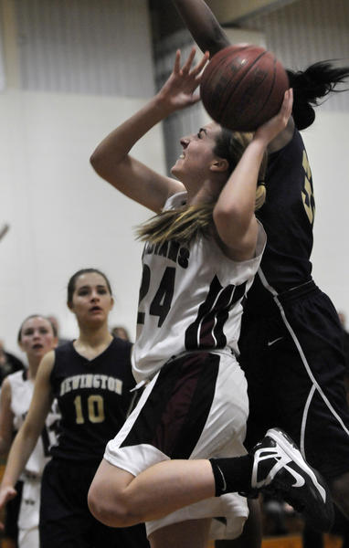 Farmington's Bridget Kelly gets fouled by Newington's Kayla Guest in the first half.