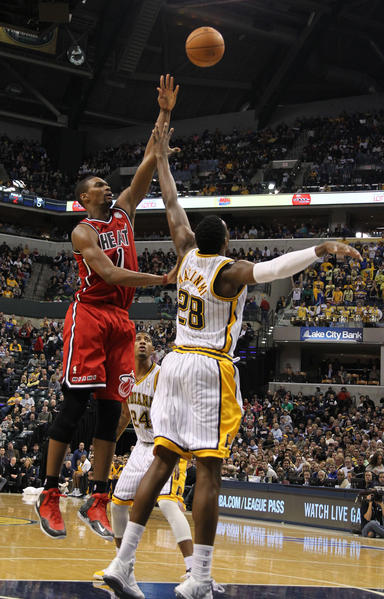 Miami Heat center Chris Bosh (1) takes a shot against Indiana Pacers center Ian Mahinmi (28) at Bankers Life Fieldhouse.