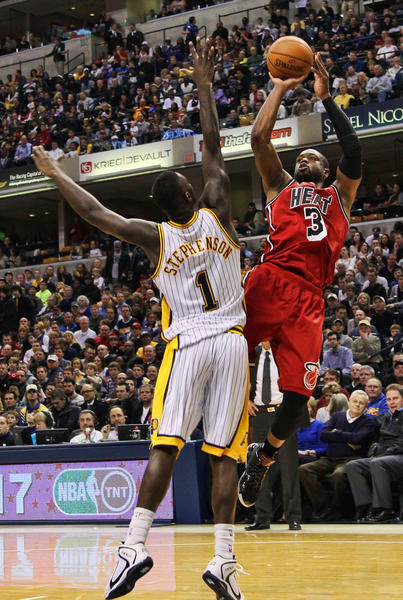 Miami Heat guard Dwyane Wade (3) takes a shot against Indiana Pacers guard Lance Stephenson (1) at Bankers Life Fieldhouse.
