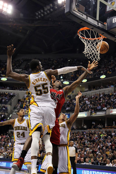 Miami Heat forward Lebron James (6) takes a shot against Indiana Pacers center Roy Hibbert (55) at Bankers Life Fieldhouse.