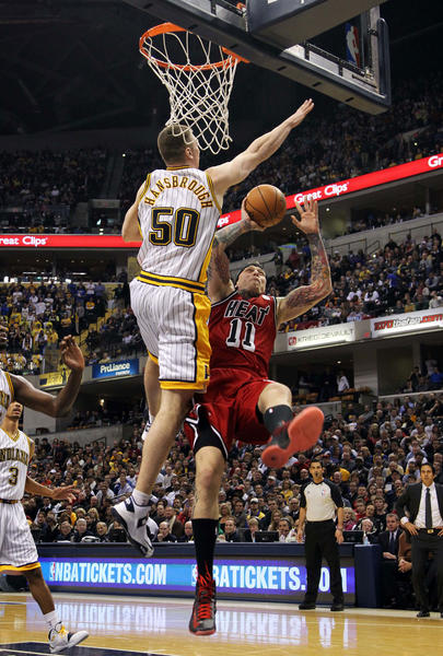 Miami Heat forward Chris Andersen (11) makes a shot and gets fouled by Indiana Pacers forward Tyler Hansbrough (50) at Bankers Life Fieldhouse.