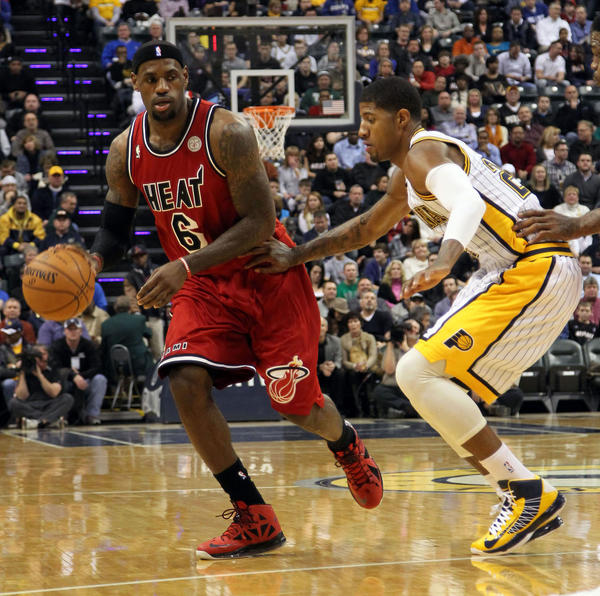 Miami Heat forward LeBron James (6) drives to the basket against Indiana Pacers forward Paul George (24) at Bankers Life Fieldhouse.