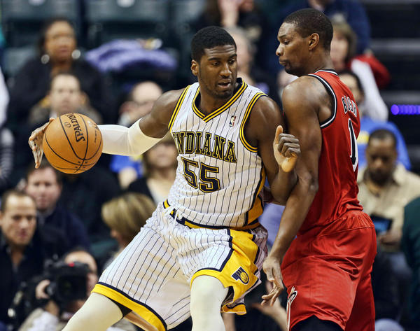 Miami Heat center Chris Bosh (1) defends Indiana Pacers center Roy Hibbert (55) as he posts up at Bankers Life Fieldhouse.