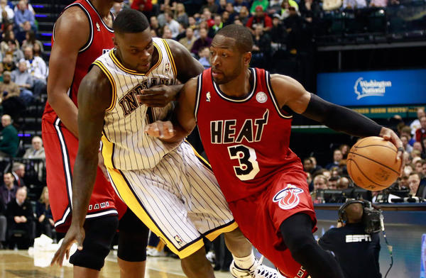 Miami Heat guard Dwyane Wade (3) pushes his way past Indiana Pacers guard Lance Stephenson during the second quarter of their NBA basketball game in Indianapolis, Indiana February 1, 2013.