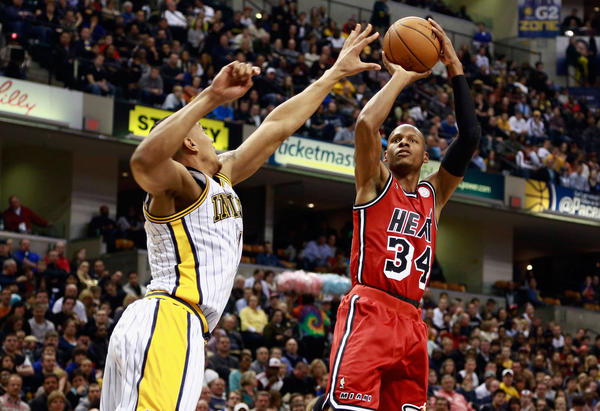 Miami Heat guard Ray Allen (R) shoots as Indiana Pacers guard Orlando Johnson defends during the first quarter of their NBA basketball game in Indianapolis, Indiana February 1, 2013.