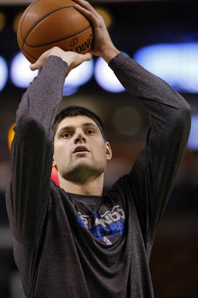 Orlando Magic center Nikola Vucevic (9) warms up before the start of the game against the Boston Celtics at the TD Garden.