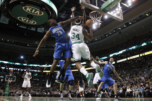 Orlando Magic small forward DeQuan Jones (20) defends against Boston Celtics small forward Paul Pierce (34) during the first quarter at the TD Garden.
