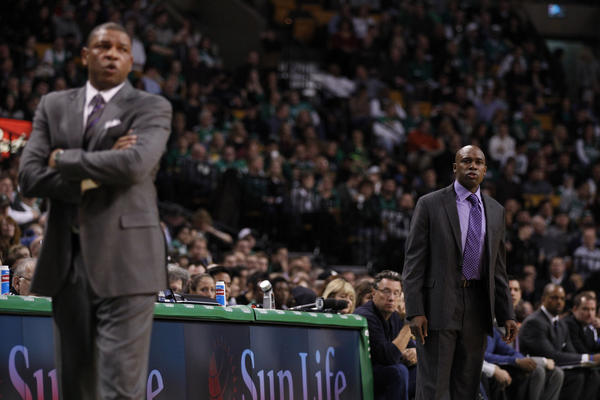 Orlando Magic head coach Jacque Vaughn (right) and Boston Celtics head coach Doc Rivers watch from the sideline during the first quarter at the TD Garden.