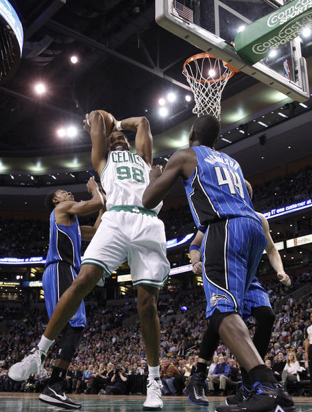 Boston Celtics center Jason Collins (98) grabs the rebound against Orlando Magic power forward Andrew Nicholson (44) during the first quarter at the TD Garden.