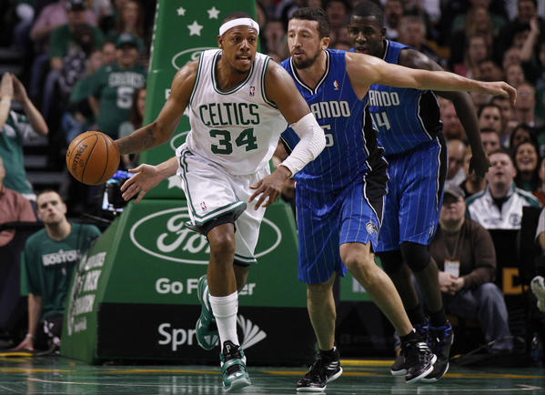 Boston Celtics small forward Paul Pierce (34) returns the ball against Orlando Magic small forward Hedo Turkoglu (15) during the second quarter at the TD Garden.