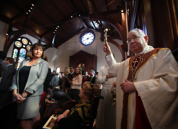 Los Angeles Archbishop Jose H. Gomez, seen presiding over a dedication ceremony in December, relieved his predecessor, Cardinal Roger M. Mahony, of his remaining public duties in the church.