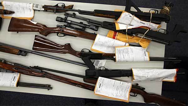 Two tables side by side, were filled with recently recovered firearms displayed at the Calumet District police station in Chicago, Monday, Jan. 28, 2013, to coincide with a press conference to announce the large number of gun seizures throughout Chicago.
