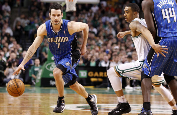 Orlando Magic shooting guard J.J. Redick (7) drives the ball against Boston Celtics shooting guard Courtney Lee (11) during the second half at the TD Garden.