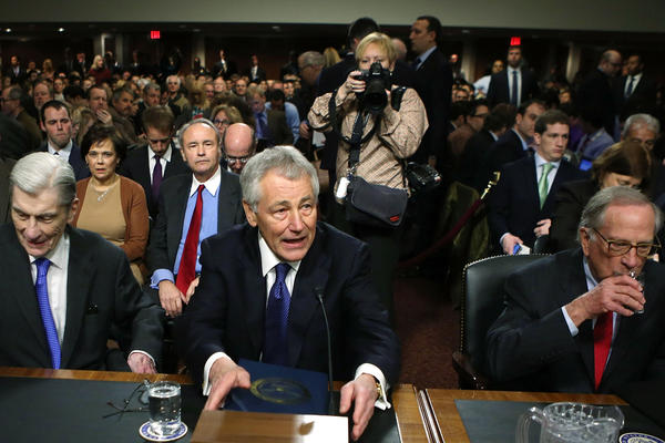 Former Sen. Chuck Hagel (R-Neb.), center, takes a seat at his confirmation hearing to become the next secretary of defense on Capitol Hill. During the nearly eight hours of Hagels hearing, no more than 10 minutes were spent on Afghanistan.