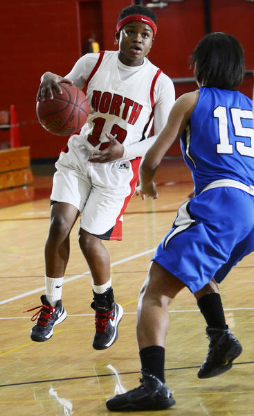 North Hagerstown's Crystal McLeod (12) looks to drive past Boonsboro's Kaylah Green (15) during Friday night's MVAL Antietam girls basketball game.