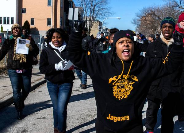 Javonnia Edmonds, 36, right, marches with members of Roseland CeaseFire and students from King College Prep High School as they honor King student Hadiya Pendleton, who was gunned down on Tuesday.