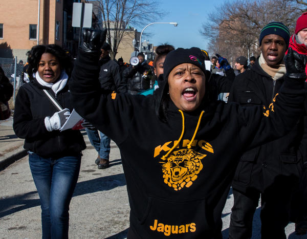 Javonnia Edmonds, right, marches with Roseland CeaseFire members and King College Prep students for Hadiya Pendleton, who was gunned down on Tuesday. They marched from King Prep High School to Harsh Park, the scene of the shooting.