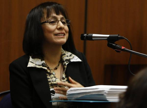 Lourdes Garcia, Bell's former director of administrative services, testifies at a preliminary hearing in 2011. On Friday, she testified that former City Manager Robert Rizzo regarded council members as unsophisticated and easily manipulated, and disapproved when he learned that a staff member was taking an ethics class.