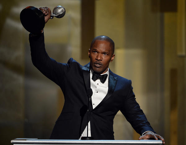 Actor Jamie Foxx acceps the Entertainer of the Year award at the 44th NAACP Image Awards.