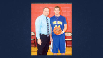 Shanksville head coach Robert Snyder, left, stands with senior Carter Slade, who surpassed the 1,000 career-point milestone on Friday night at Meyersdale.