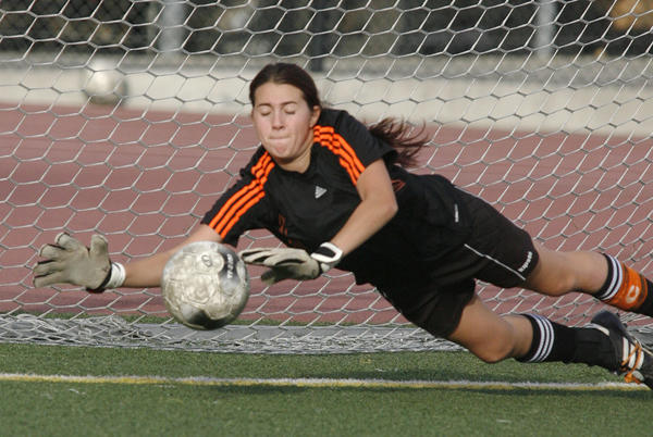 South Pasadena's goal keeper Angelique Ulmer, on a point blank drill of a shot, dives and makes a save against San Marino in the first half of a Rio Hondo League girls soccer match at South Pasadena High School in a on Friday, February 1, 2013. The game ended in a 2-2 tie.
